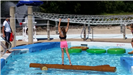 Girl Inching Across Log in Activity Pool